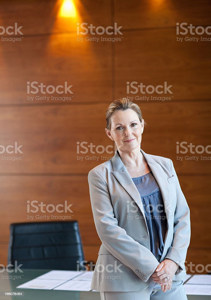Smiling businesswoman in conference room royalty-free stock photo