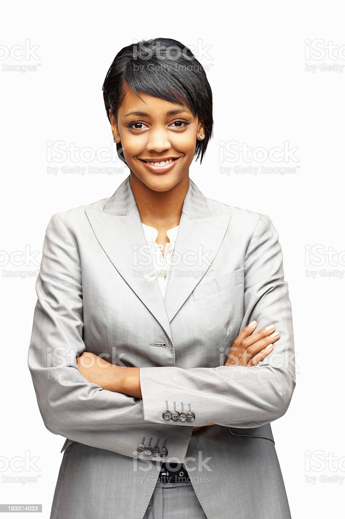Smiling businesswoman in gray suit with arms crossed stock photo