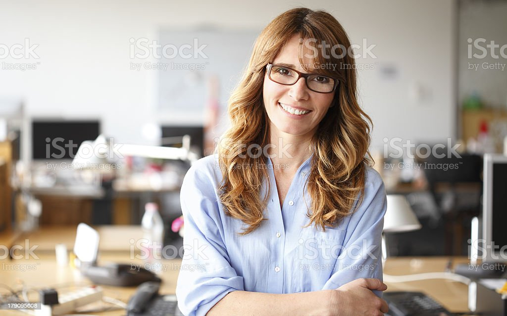 Smiling businesswoman in office royalty-free stock photo