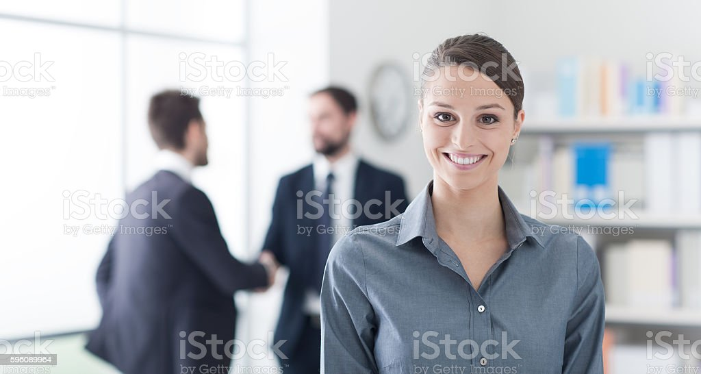 Smiling businesswoman in the office royalty-free stock photo