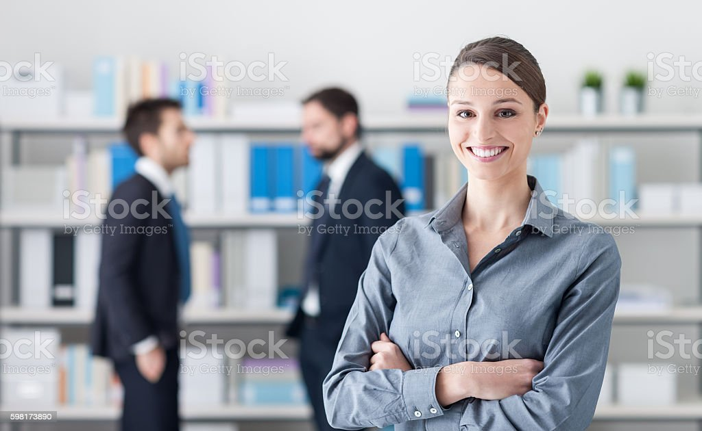 Smiling businesswoman in the office stock photo