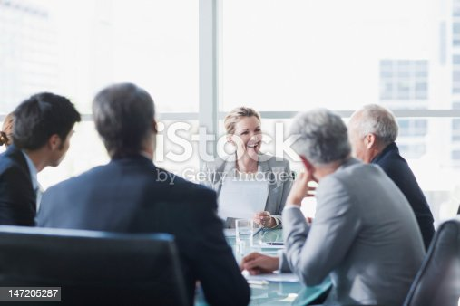 istock Smiling businesswoman leading meeting in conference room 147205287