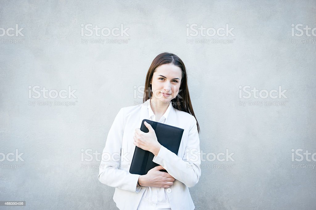 Smiling Businesswoman Leaning Against Wall Portrait royalty-free stock photo