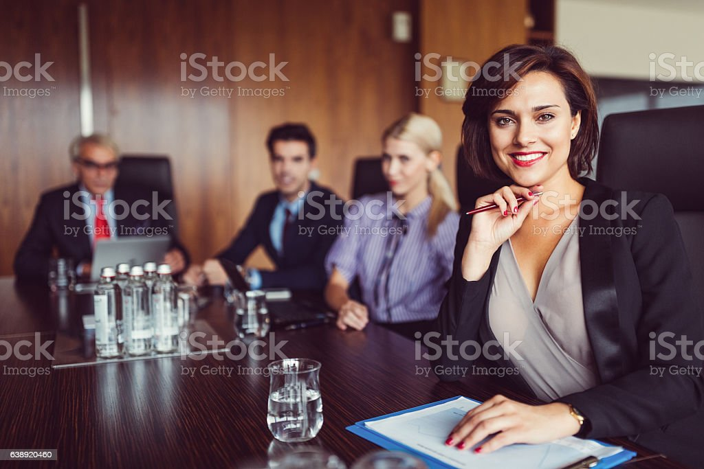 Smiling businesswoman looking at camera stock photo