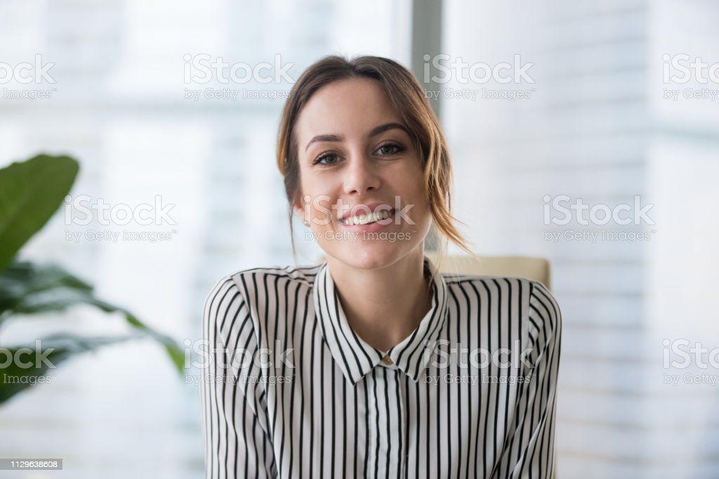 Smiling businesswoman looking at camera webcam make conference business call - Royalty-free A usar um telefone Foto de stock
