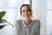 istock Smiling businesswoman looking at camera webcam make conference business call 1129638608