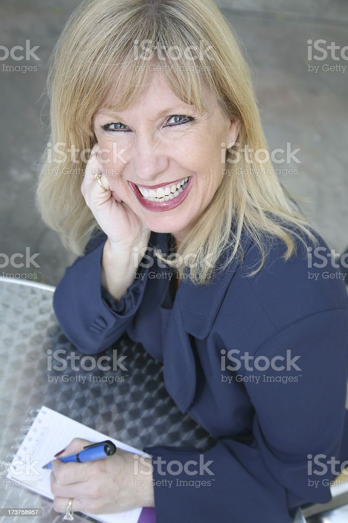 Smiling Businesswoman Making A To Do List royalty-free stock photo