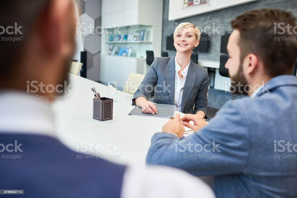 Smiling Businesswoman Meeting  Partners in Office stock photo