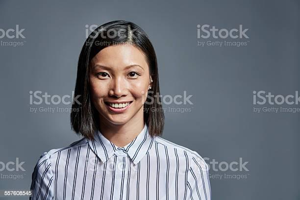 Smiling businesswoman over gray background picture id557608545?b=1&k=6&m=557608545&s=612x612&h=rursto9rsx8 3zzhezq0smcfmeidyzcvvfflmaicwrq=
