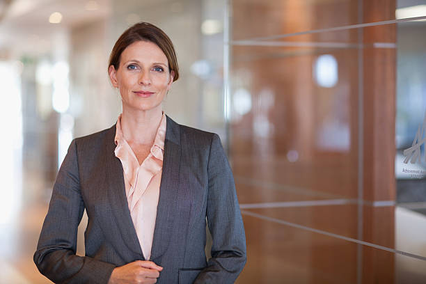 smiling businesswoman - woman suit stock photos and pictures