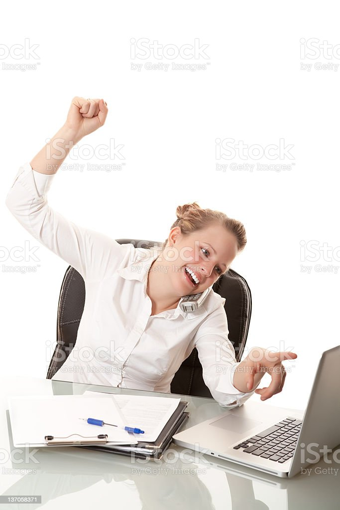 Smiling businesswoman pointing at her computer royalty-free stock photo