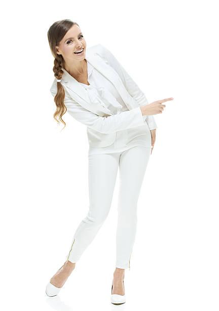 Smiling businesswoman pointing away stock photo