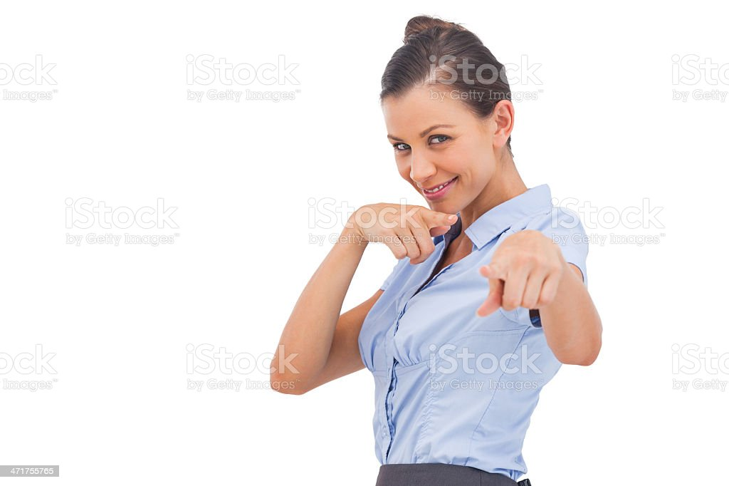 Smiling businesswoman pointing something with fingers royalty-free stock photo