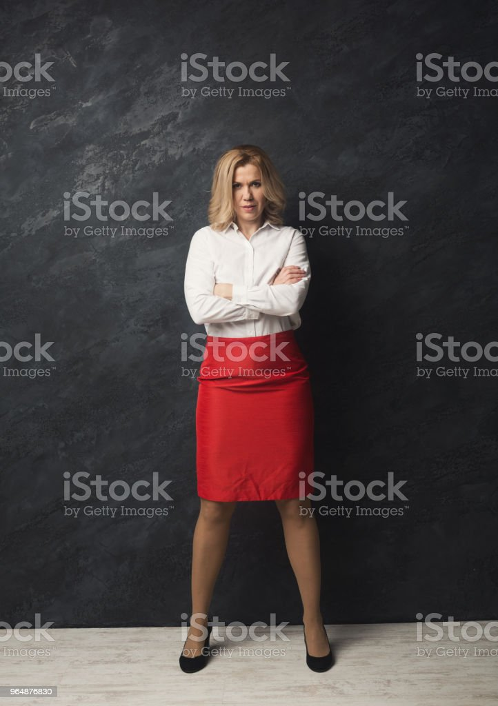 Smiling businesswoman portrait at gray studio background royalty-free stock photo
