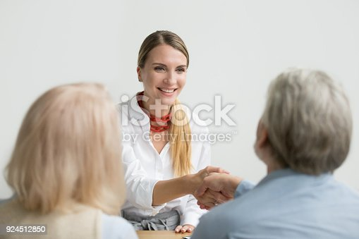 istock Smiling businesswoman shaking hand of senior hr at job interview 924512850