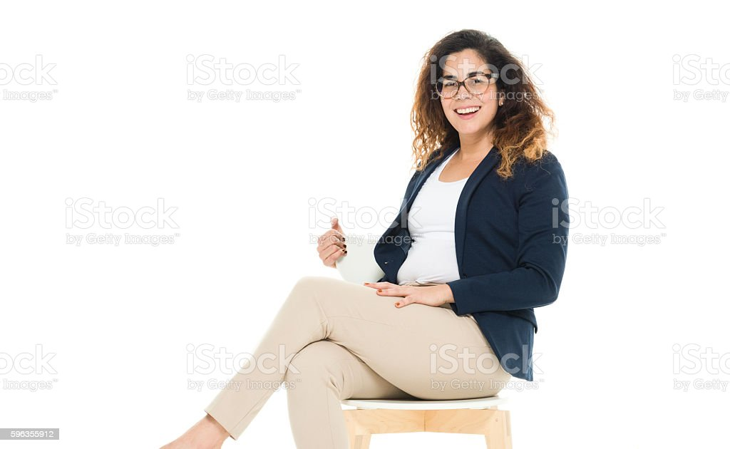 Smiling businesswoman sitting on chair royalty-free stock photo