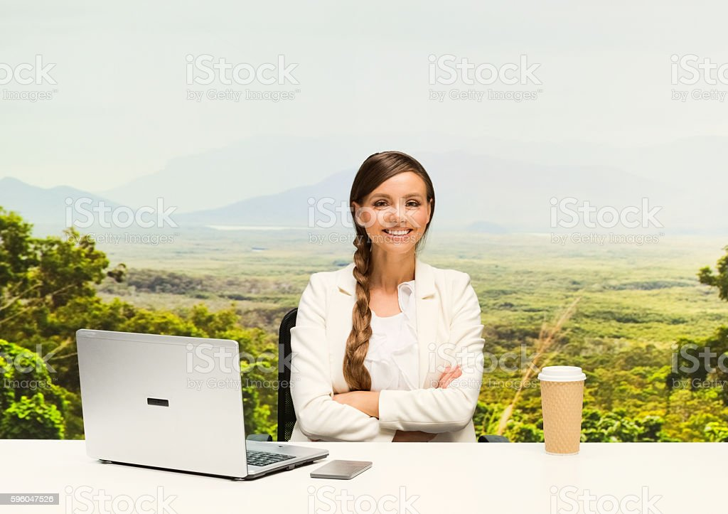 Smiling businesswoman sitting outdoors royalty-free stock photo