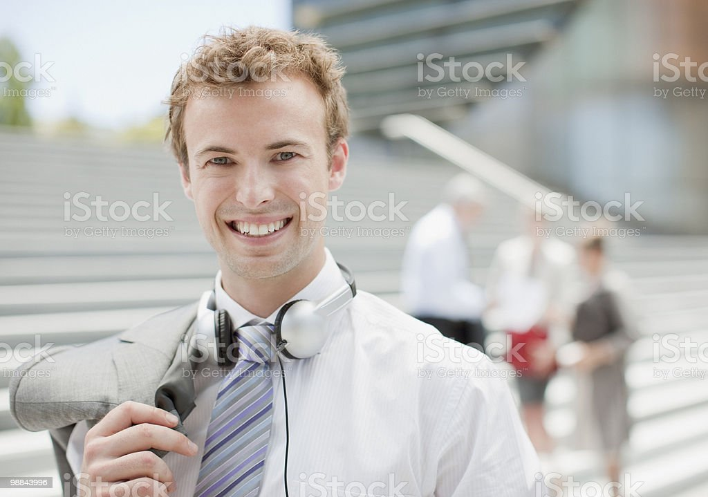 Smiling businesswoman standing outdoors royalty free stockfoto