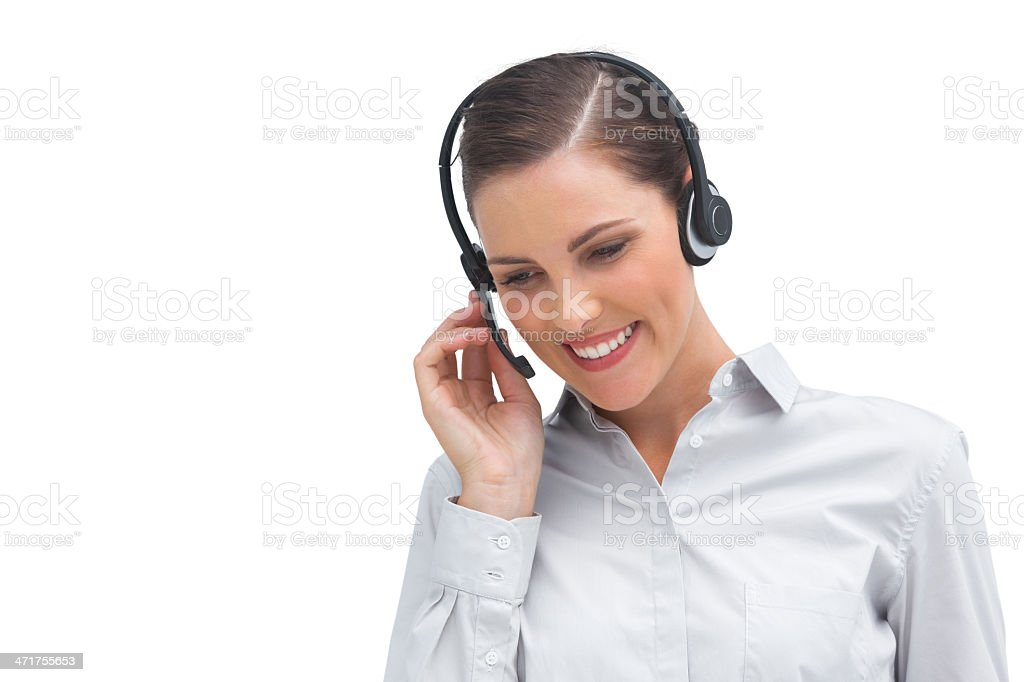 Smiling businesswoman talking on headset royalty-free stock photo