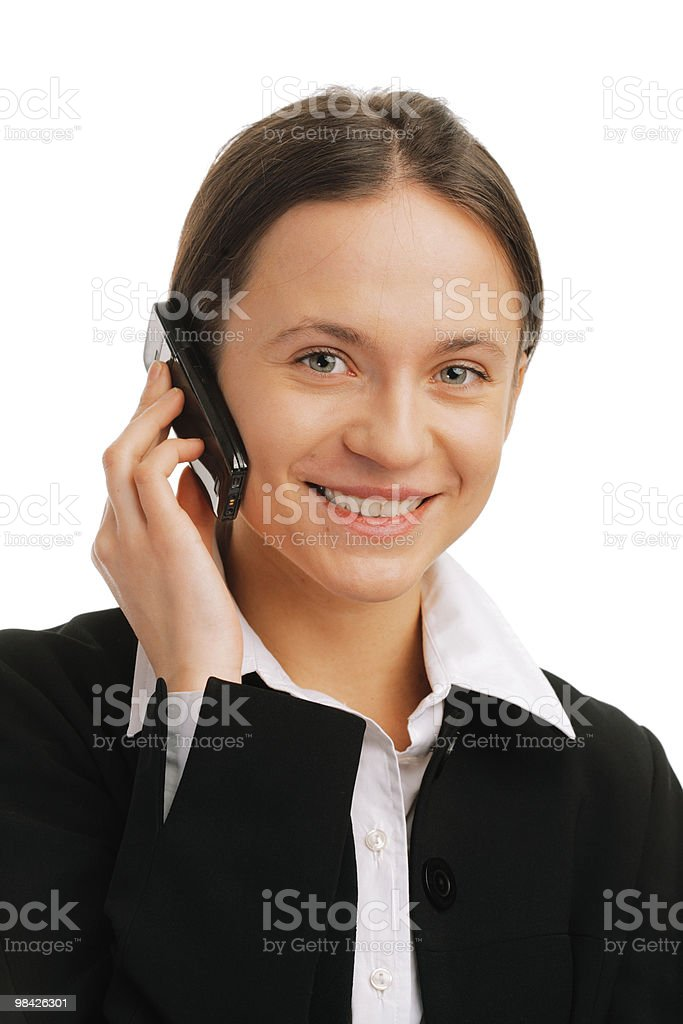 Sorridente donna d'affari di parlare al cellulare foto stock royalty-free