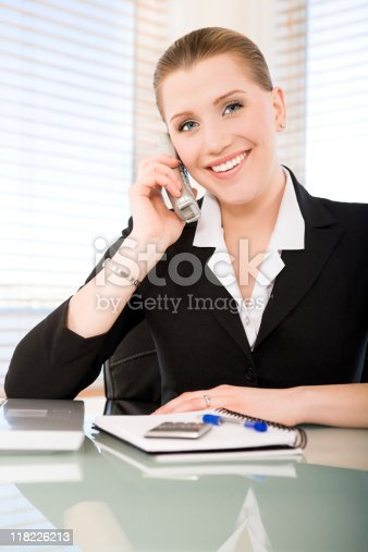 istock Smiling businesswoman talking on the phone 118226213