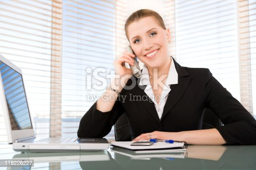 istock Smiling businesswoman talking on the phone 118226227