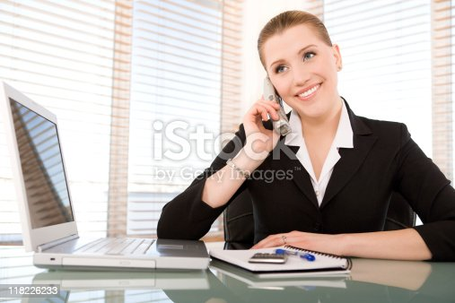 istock Smiling businesswoman talking on the phone 118226233