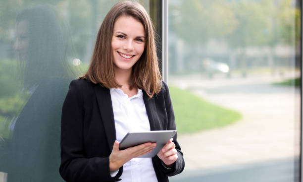 Smiling businesswoman using a digital tablet outdoor stock photo