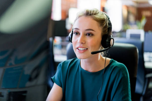 Smiling businesswoman wearing headset at office stock photo
