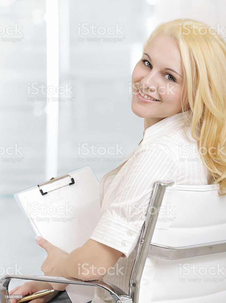 Smiling businesswoman with a notepad. stock photo