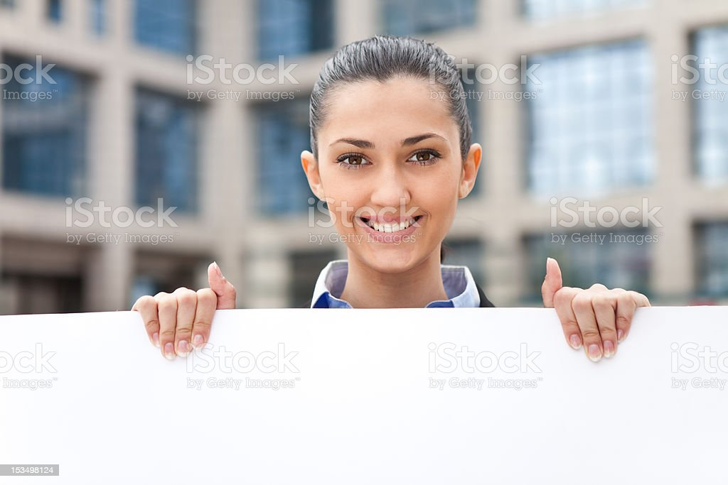 smiling businesswoman with banner royalty-free stock photo