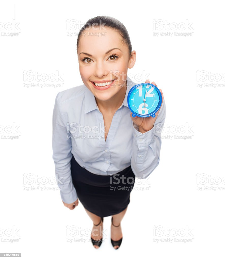 smiling businesswoman with blue clock stock photo