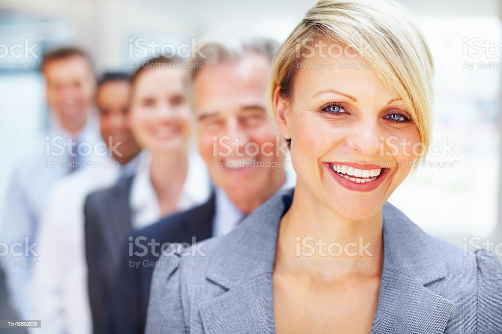 Smiling businesswoman with colleagues in the background royalty-free stock photo