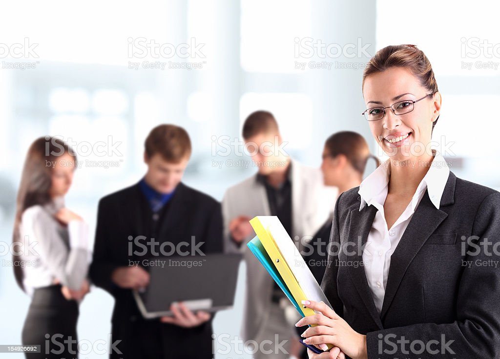 Smiling businesswoman with colleagues. royalty-free stock photo