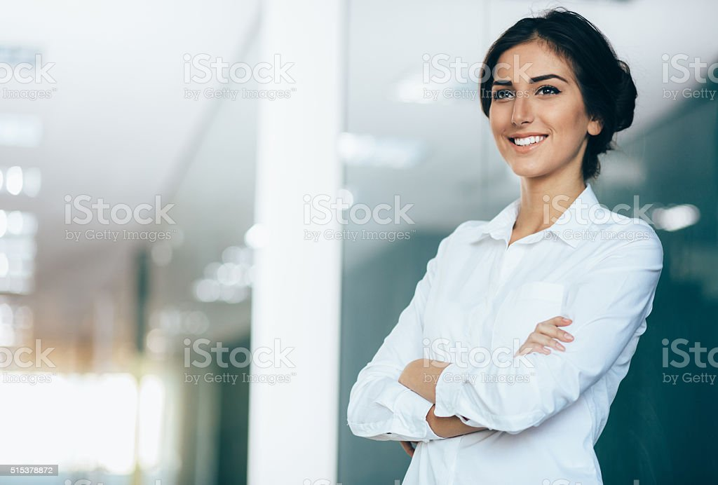 Smiling businesswoman, with copy space stock photo