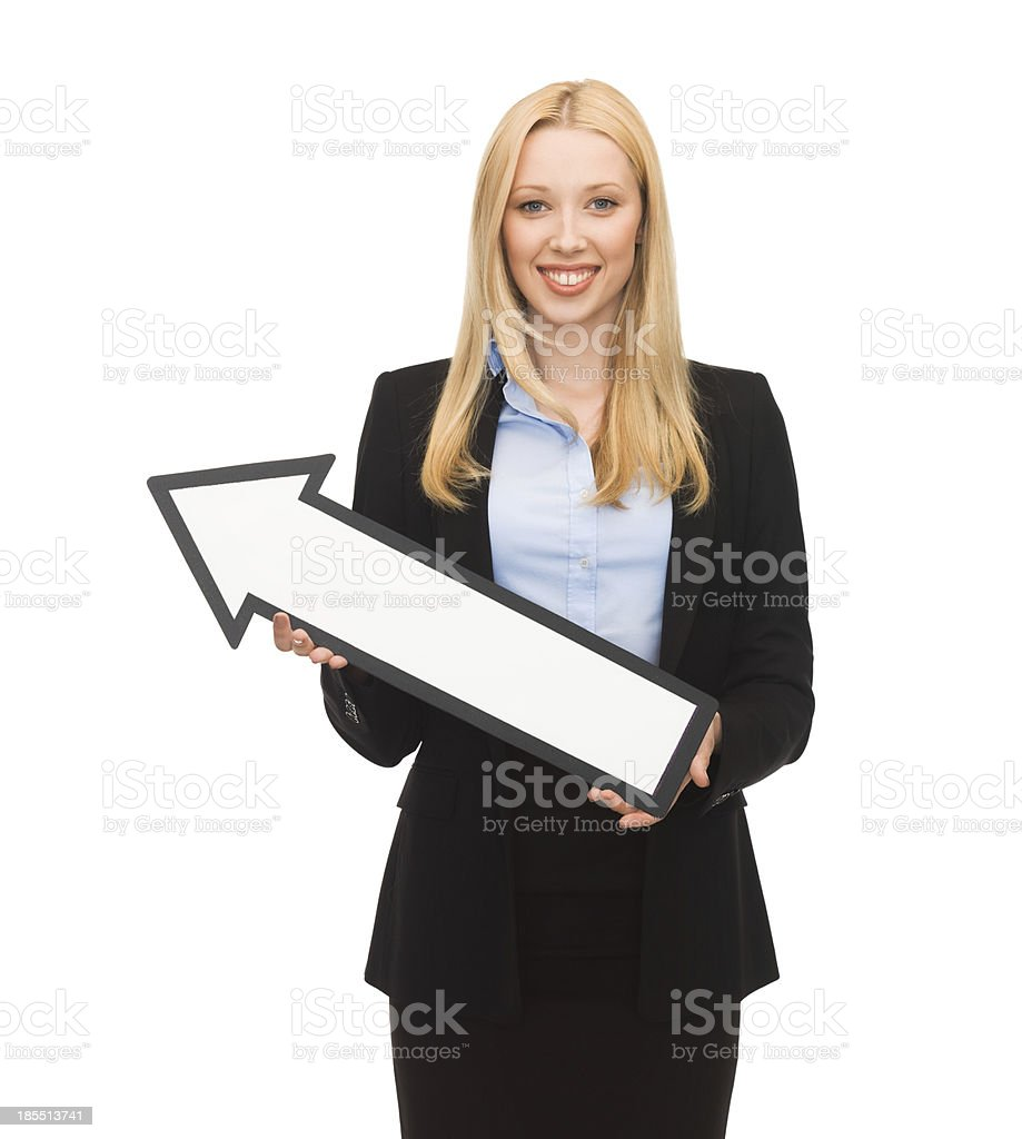 smiling businesswoman with direction arrow sign royalty-free stock photo