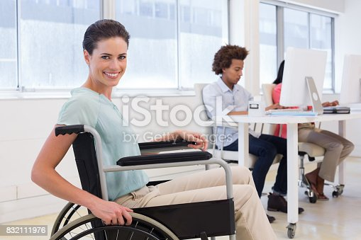 660681964istockphoto Smiling businesswoman with disabilitity 832111976