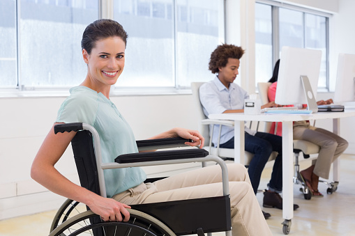 660681964 istock photo Smiling businesswoman with disabilitity 832111976