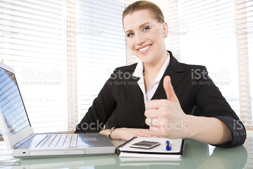 Smiling businesswoman with her thumb up royalty-free stock photo