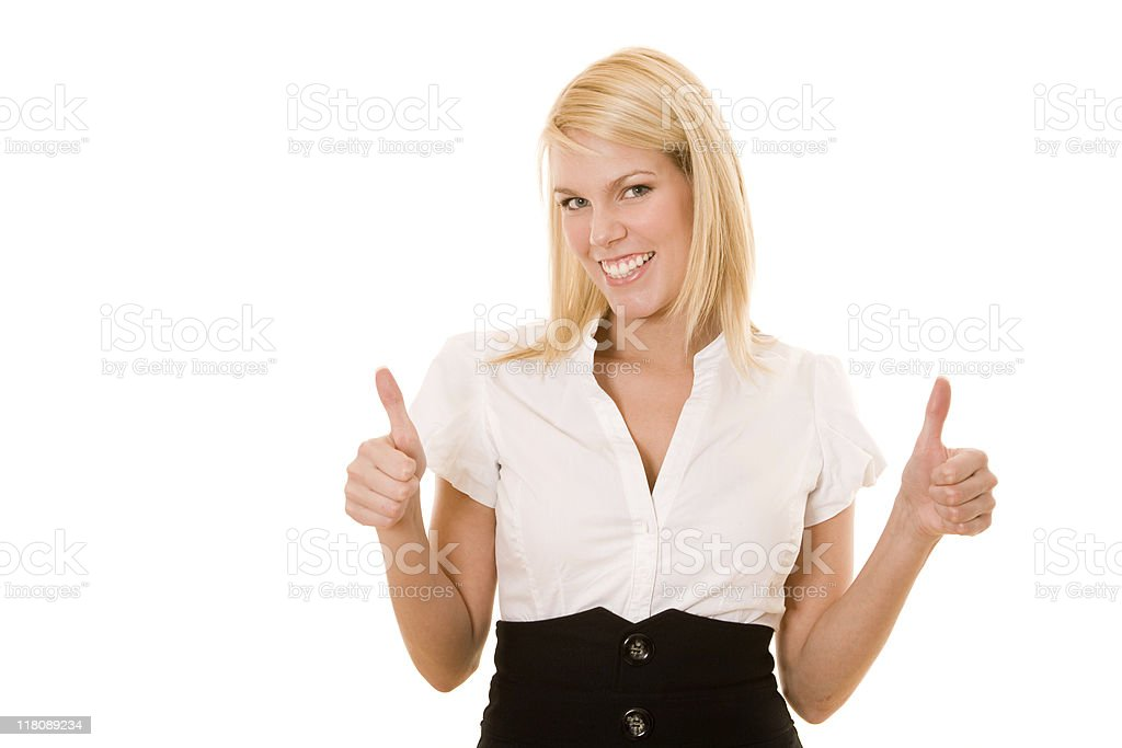 Smiling businesswoman with her thumbs up royalty-free stock photo