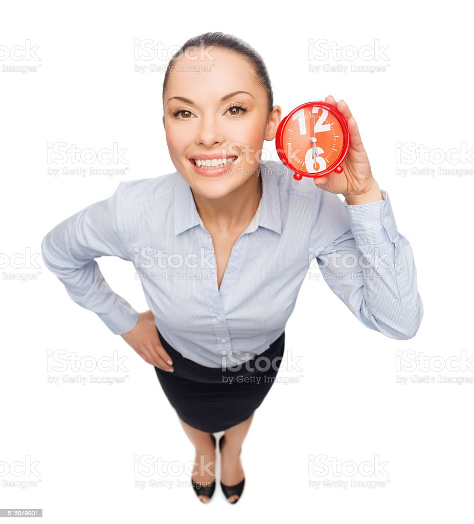 smiling businesswoman with red clock stock photo