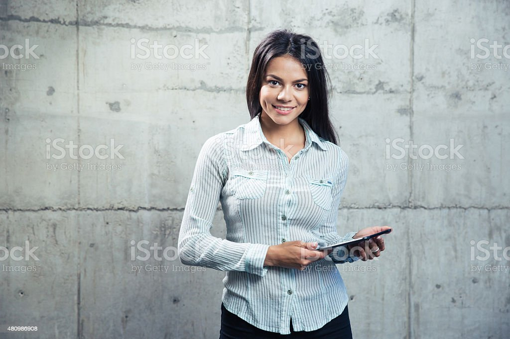 Smiling businesswoman with tablet computer stock photo