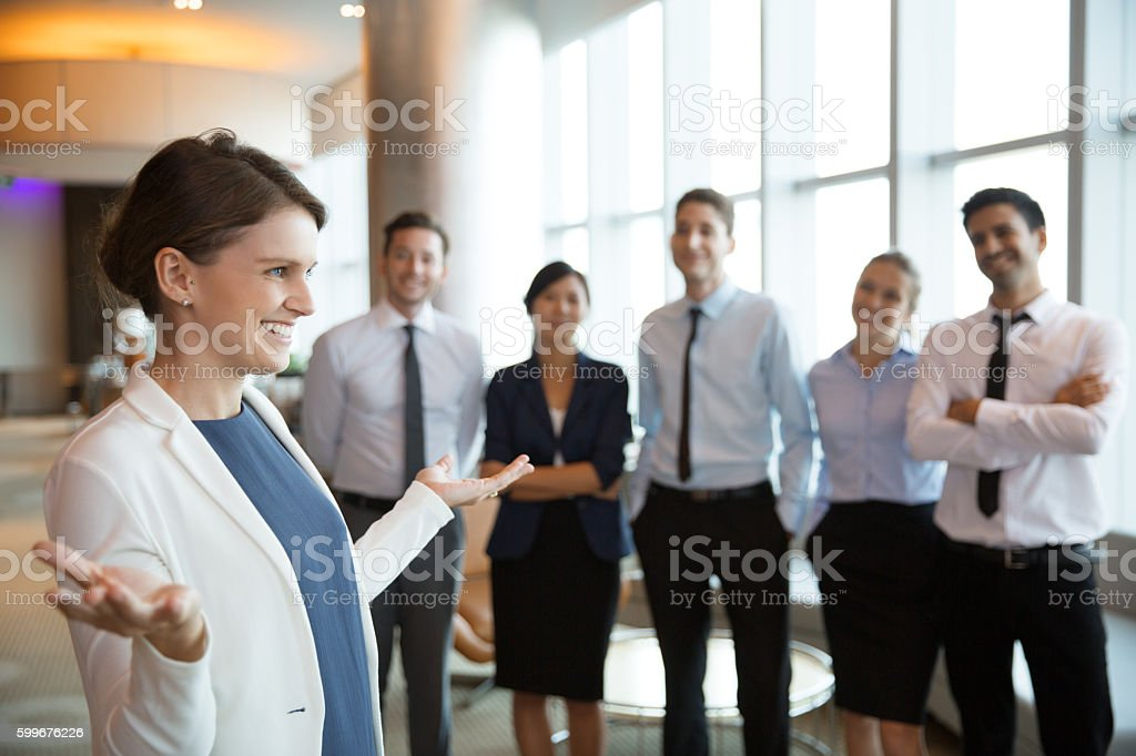 Smiling Businesswoman with Team stock photo