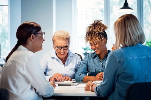 Smiling Businesswomen Working In New Office Stock Photo - Download Image Now