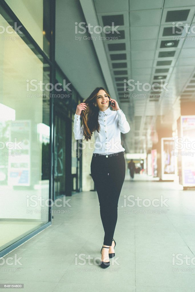 smiling bussineswoman speaking on mobile stock photo