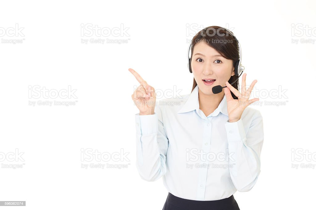 Smiling call center operator royalty-free stock photo