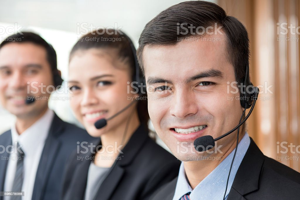 Smiling call center (or telemarketer) team royalty-free stock photo