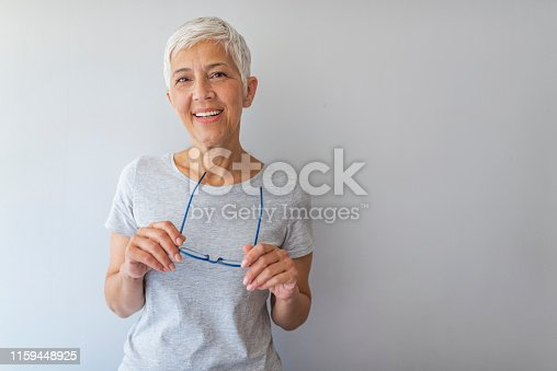 istock Smiling carefree woman with Eyeglasses. 1159448925