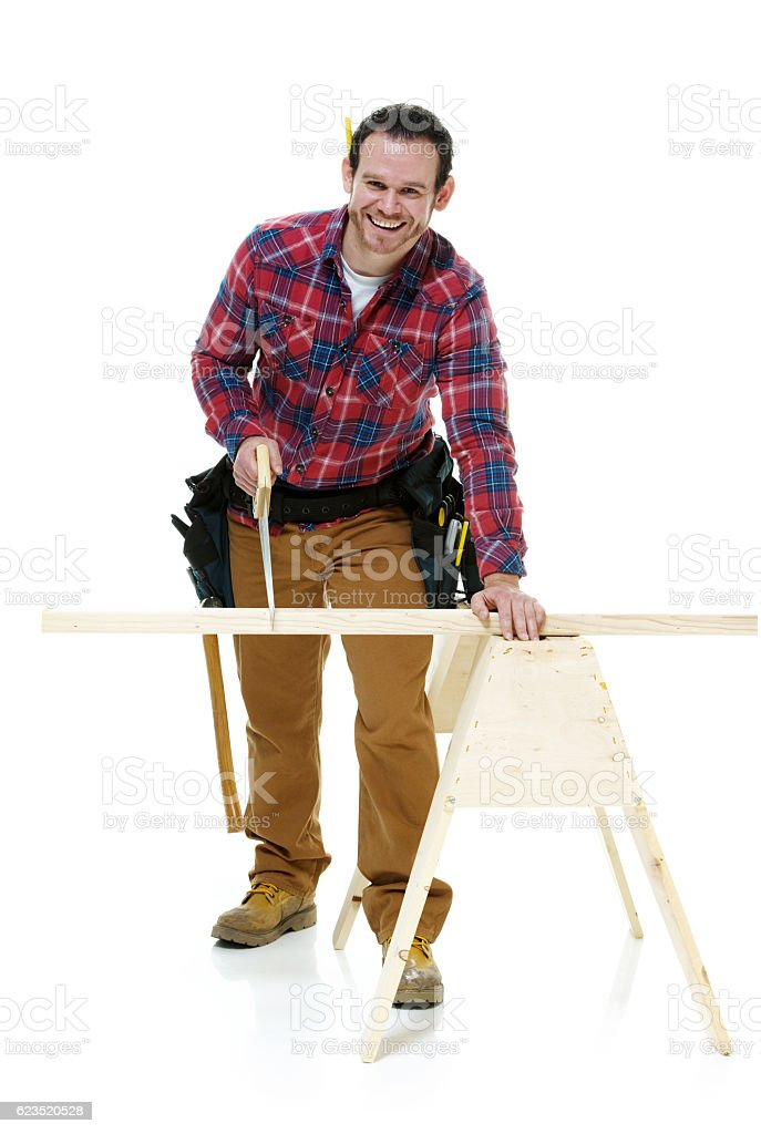 Smiling carpenter working stock photo