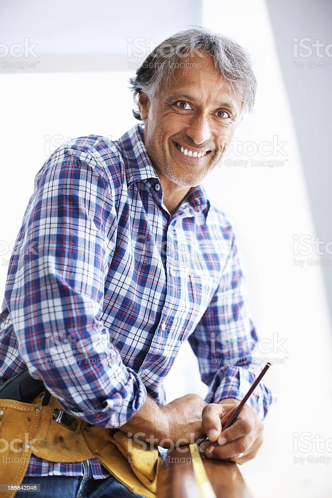 Smiling carptenter at work royalty-free stock photo